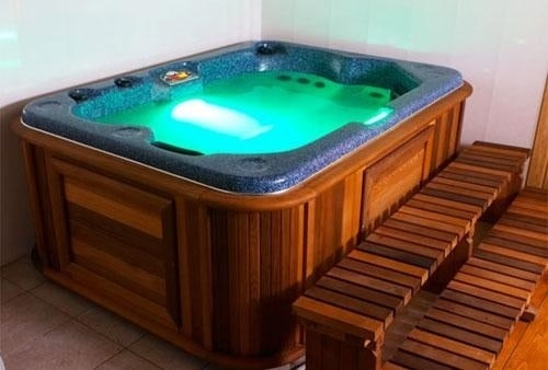 arctic spas hot tub with green lights